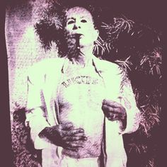 """""""Lucifer Frying"""" is an image of #KennethAnger with blacked out eyes and the tongue of a snake with an #acid #blotter on the end."""