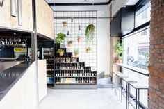 """Mezzo Atelier designed and realised the interiors and furniture of a craft beer store & shop at the core of the old """"Isola's"""" neighbourhood in Milan. Craft Beer Shop, Interior Stylist, Interior Design, Brew Shop, Beer Store, Café Bar, Space Interiors, Cafe Shop, Kids Decor"""