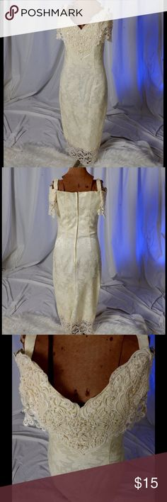 Beautiful Cream colored vintage dress Beautiful cream colored vintage dress with lace on the bottom and top.  Beading is added to the lace on top.  Dress is fully lined and the material is 60% cotton and 40% acetate.and must be dry cleaned. cachet Dresses