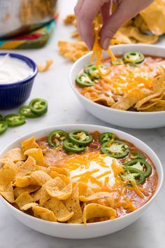 The favorite Texan dip makes its soup debut: essentially a chili topped with Fritos, sour cream, cheddar, and sliced jalapeños. Get the recipe from Delish. - Delish.com