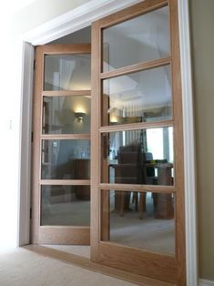 Internal doors made from oak with glass paneling throughout; providing a simple … Internal doors made from oak with glass paneling throughout; providing a simple yet elegant transition from living room to dining room. Internal Wooden Doors, Internal Double Doors, Internal Doors With Glass, Internal French Doors White, Double Glass Doors, Oak Doors, Entry Doors, Panel Doors, Front Entry