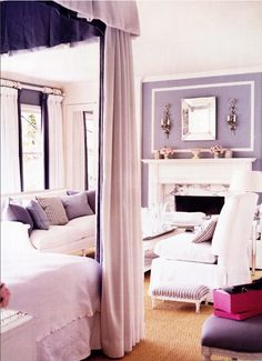 Grey bedroom with canopy, fireplace, sitting area - Mary McDonald