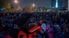 Protesters listen to a piano performance at Taksim Square on Tuesday in Istanbul, Turkey