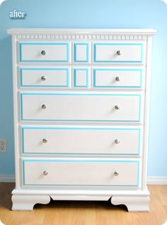 I love the white dresser with the pop of blue in the details.