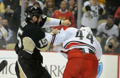 Glass and Harrison exchange a few friendly blows during the first game against the Hurricanes this year 10/8/13