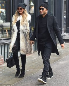 Keeping warm: Chrissy worked a wintry chic get-up while strolling around frigid New York C...
