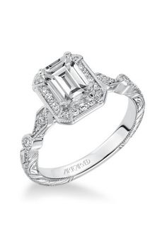 This vintage inspired rectangular halo ring is the perfect pick for any Gatsby-loving bride-to-be: http://www.stylemepretty.com/2014/11/01/30-of-our-most-coveted-engagement-rings/