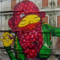 Street art : Detail of a painted on the facade of a building abandoned by brothers Os Gemeos in Lisbon as part of Project CRONO in Portugal.