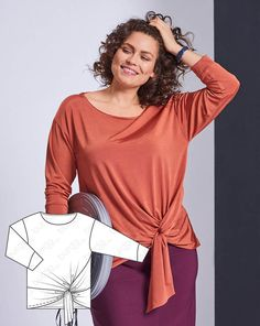 The sophisticated shine of the fabric catches the eye, the design follows the figure, the dropped shoulders and sophisticated knotted detail at the hem add up to a casual and office ready look.