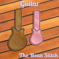 Guitar - Includes Two(2) Sizes!  #thebeanstitch #beanstitchers #TBS #ith #inthehoop #machineembroidery #felties #feltie #embroidery #digitaldownload #keyfobs #bagtag #diy #snaptab #snapbean #handmade #vinyl #felt #craft #etsy #shopsmall #embroiderygift #travel #everyday #design #multipurpose #guitar #band #music #note #play #rockon #keychain Kam Snaps, Glitter Vinyl, Tbs, Key Fobs, Machine Embroidery Designs, Stitching, Applique, Geek Stuff, Guitar