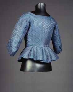 Rear view, caraco jacket, c. 1760-1780. Blue silk woven with a regular geometric pattern.