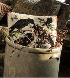 A Crock to Crow About: Nestled in a bed of fall berries inside a large crock, a soft-to-the-touch wool pillow with a crow appliqué spreads harvesttime cheer next to the sofa in Kathleen Wedin\ Country Primitive, Primitive Sheep, Primitive Autumn, Primitive Antiques, Country Sampler Magazine, Woodlands Cottage, Old Crocks, Broken Wings, Stoneware Crocks