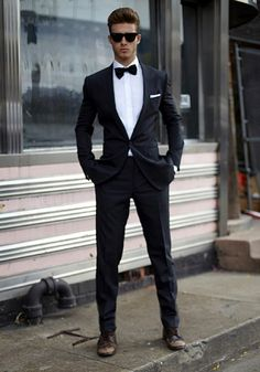 This outfit is classic and fancy, which is perfect for prom. The classic suit and bow tie give the meaning to a formal event. It fits the body nicely and gives it a fancy touch. The sunglasses match all the black in the suit overall it is a good match.