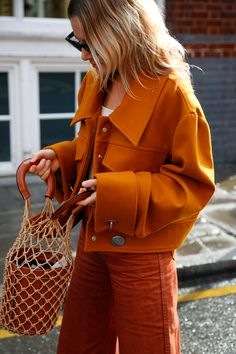 on trend + seasonal | color denim in fall appropriate orange hues.