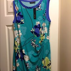 APT. 9 Sleeveless Dress APT. 9 Sleeveless Dress | Turquoise Floral Design | Piping around neck and sleeves in periwinkle | Black band around bottom | Gathering on left side for slimming effect. | Soft and comfortable | 96% Polyester and 4% Spandex.                                                                 Smoke-free household. Apt. 9 Dresses