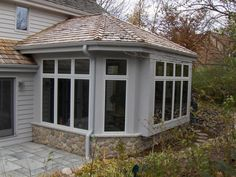 Sunroom addition in Brookfield, Wisconsin.  Designed by Matthew Krier of Design Group Three.