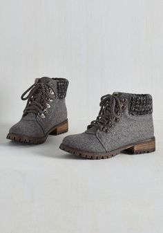 In on the Traction Boot. Stylish enough for an art crawl, but rugged enough to climb a tree, these wooly grey boots see that you wont miss a beat! #grey #modcloth
