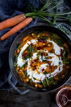 """Tunisian Chickpea Stew with carrots & tops, turmeric, kale and """"quick"""" harissa sauce- keep it vegan or add yogurt, for a delicious, healthy one-pot meal."""