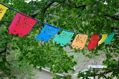 make waterproof fiesta decorations for outside parties using dollar store plastic tablecloths