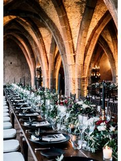 Dark academia wedding reception with cathedral arches and black candlesticks