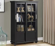 This Glass Door Bookcase provides an attractive showcase for books, decorative items and more. This elegant bookcase features 2 sliding glass doors with 4 shelves inside. 4 Shelf Bookcase, Bookcase With Glass Doors, Black Bookcase, Glass Shelves, Bookcases, Library Bookshelves, Wooden Bookcase, Wall Shelves, Glass Panel Door