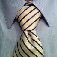 pratt knot tie on white and blue striped tie