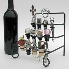 $15.00-$24.95 Wine Bottle Stopper Display Rack or Stopper Stand - Holds 12 Stoppers (Not Included) - Tiered vintage-themed rack showcases 12 decorative bottle stoppers.     (Stoppers not included). http://www.amazon.com/dp/B002MFL7NK/?tag=pin2wine-20