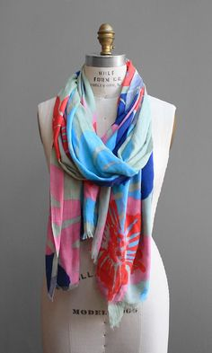 Tropic Leaves Scarf. OK so $38 may seem like a lot but pair this with a plain white top and khakis and you're instantly put together.