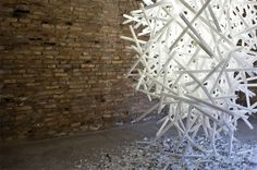 Hitoshi Kuriyama creates elaborate light installations using complex clusters of shattered fluorescent light bulbs. His latest work can be seen starting June 4th in Venice at Glasstress 2011. (via notcot)