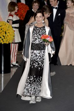 H.R.H. Princess Caroline of Hanover, Bal de la Rose, Monaco 2014 She has a knee injury that's why she wears sneakers to her Chanel gown