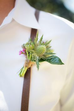groomsmen boutonniere with thistle - photo by Zoom Theory http://ruffledblog.com/intimate-backyard-wedding-in-malibu