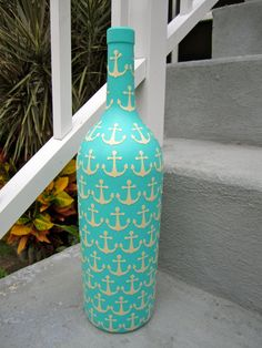 Wine bottle painted blue with white anchors. This is adorable. Give to your sorority sister on her 21st and have the chapter sign the bottle! <3
