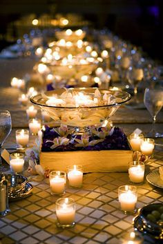 Cluster candles into groups. After the sun sets, we'd love to have the tables glow, too. These centerpieces are compromised almost entirely out of candlelight.