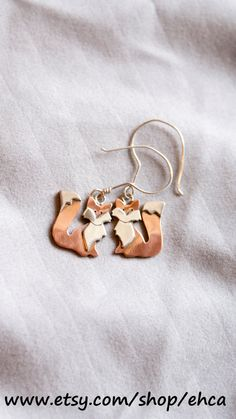These Mini Foxes are the same size as the mini fox necklace that is, 1.9cm or 1/16th of an inch. If you include the earring hook they are 4.2cm or 1 and 1/16th of an inch. They are hand made out of sterling silver and copper. These mini foxes are perfect of any lady that would like to look foxy.