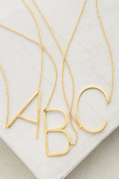 Monogram Pendant Necklace #anthropologie -- in G. love this font. very straightforward. appealing.