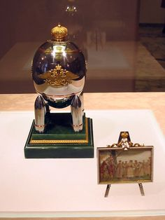 1916 - Steel Military Egg Tsar Nicholas presented the egg as an Easter gift to his wife, the Tsaritsa Alexandra Fyodorovna. The egg is one of the ten Imperial eggs that were never sold, and now is found in the Kremlin armoury. Alexandra Feodorovna, Fabrege Eggs, Faberge Jewelry, Tsar Nicholas, Imperial Russia, Egg Art, Egg Decorating, Easter Eggs, At Least