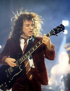 Easily one of the best guitarists EVER Angus Young of AC/DC it's pretty much impossible to not LOVE Angus he's so awesome