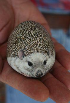Cute hedgehog painted on a rock.