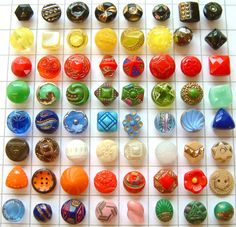 """64 Antique & Vintage """"Demi"""" Very Colourful Glass Buttons Shown in a ½"""" Grid."""