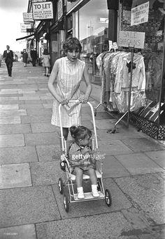 A girl pushing a pram down an east London street circa Pools For Small Yards, Vintage Pram, Prams And Pushchairs, Dolls Prams, Baby Prams, Vintage London, Baby Carriage, London Street, My Childhood Memories