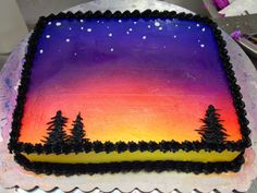 Sunset cake, this is all airbrush, the trees are piped black frosting