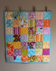 Painted Clothespins Attached To A Wall Would Make Great Temporary Quilt Hanger For Smallish Quilts