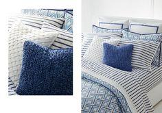 Navy & striped throw pillows paired with blue diamond-print duvet