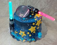 Star Wars Galaxy Cake. Buttercream cake with fondant accents. The light sabers not only light up but contain M&M's inside!