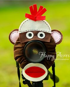 This might help the kids laugh and smile. - Lens Bling - Sock Monkey- Ready to Ship. $20.00, via Etsy.