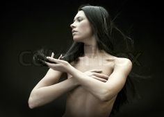 Image of 'Portrait of the beautiful naked brunette with flying hair' on Colourbox