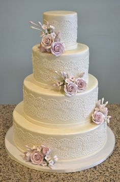 Lace patterned and sugar rose wedding cake