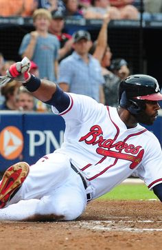 Jason Heyward #22 of the Atlanta Braves slides home for the fourth inning run against the Colorado Rockies at Turner Field.