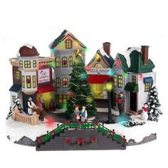 Bring holiday cheer to your space with this fun St. Nicholas Square Village Plaza with lights and motion. See the complete St. Christmas Tree Village Display, Rotating Christmas Tree, Christmas Village Collections, Lemax Christmas Village, Christmas In The City, Merry Christmas To All, Christmas Scenes, Christmas Villages, Christmas Crafts