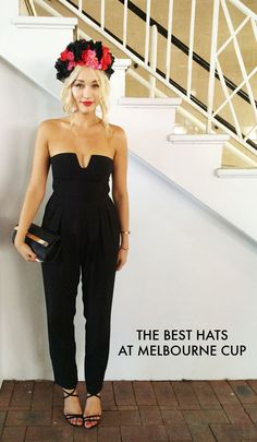 No shame in wearing a jumpsuit to the races...better than night clubwear or jeans!! She looks so chic!